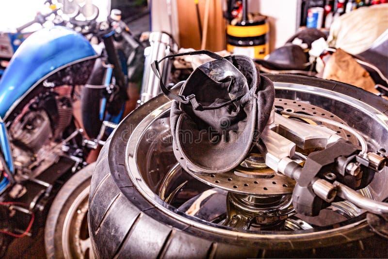 Repairing motorcycle tire with repair kit, Cap, glases, tire plug repair kit for tubeless tires. Repairing motorcycle tire with repair kit, Tire plug repair kit stock images