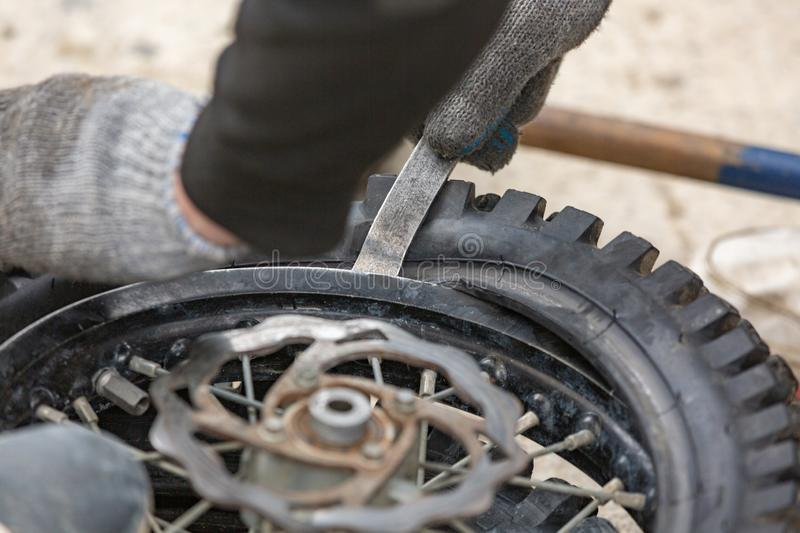 Repairing motorcycle tire with repair kit, Tire plug repair kit for tubeless tires. Repairing motorcycle tire with repair kit, Tire plug repair kit for tubeless royalty free stock photo