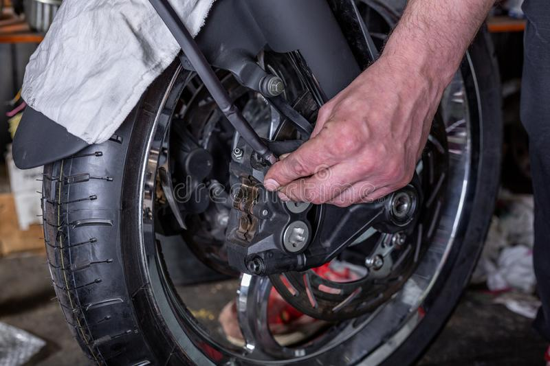 Repairing motorcycle tire with repair kit, Tire plug repair kit for tubeless tires. Repairing motorcycle tire with repair kit, Tire plug repair kit for tubeless stock photo