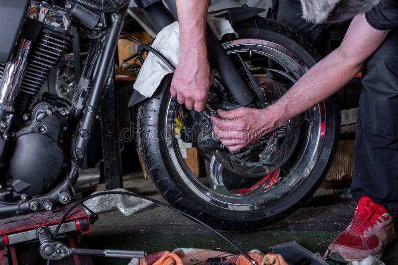 Repairing motorcycle tire with repair kit, Tire plug repair kit for tubeless tires. Repairing motorcycle tire with repair kit, Tire plug repair kit for tubeless royalty free stock images
