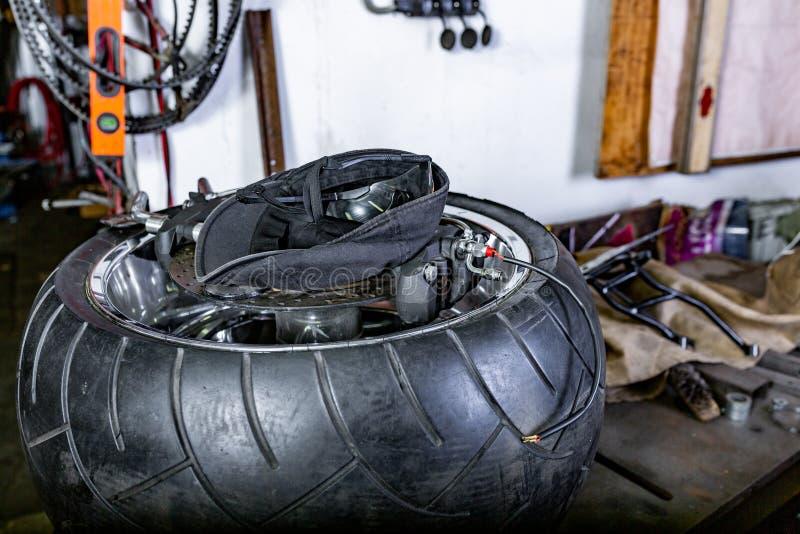 Repairing motorcycle tire with repair kit, Cap, glases, tire plug repair kit for tubeless tires. Repairing motorcycle tire with repair kit, Tire plug repair kit royalty free stock photos