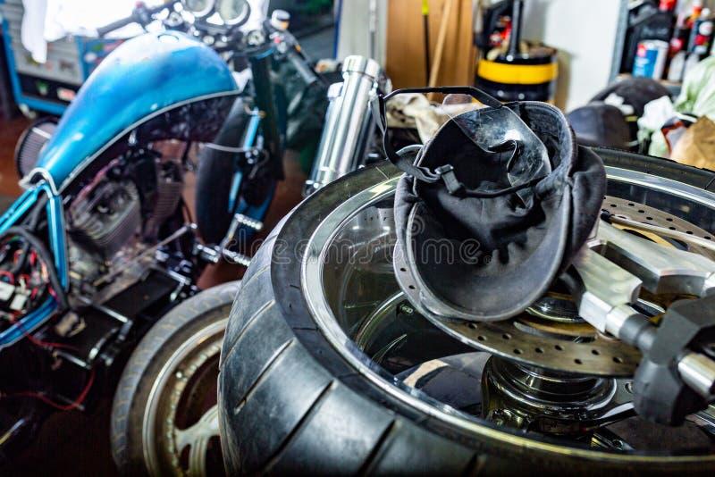Repairing motorcycle tire with repair kit, Cap, glases, tire plug repair kit for tubeless tires. Repairing motorcycle tire with repair kit, Tire plug repair kit royalty free stock photo