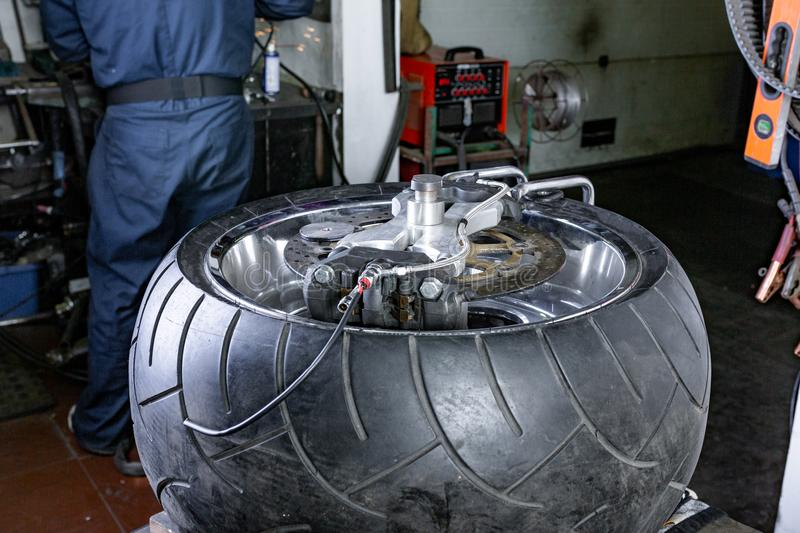 Repairing motorcycle tire with repair kit, tire plug repair kit for tubeless tires. Tire close up stock photo