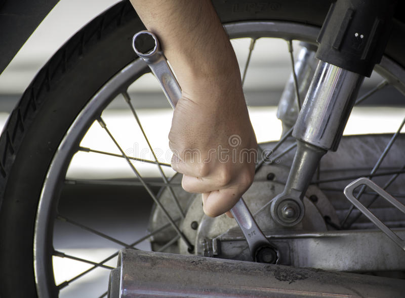 Repairing Motorcycles stock images
