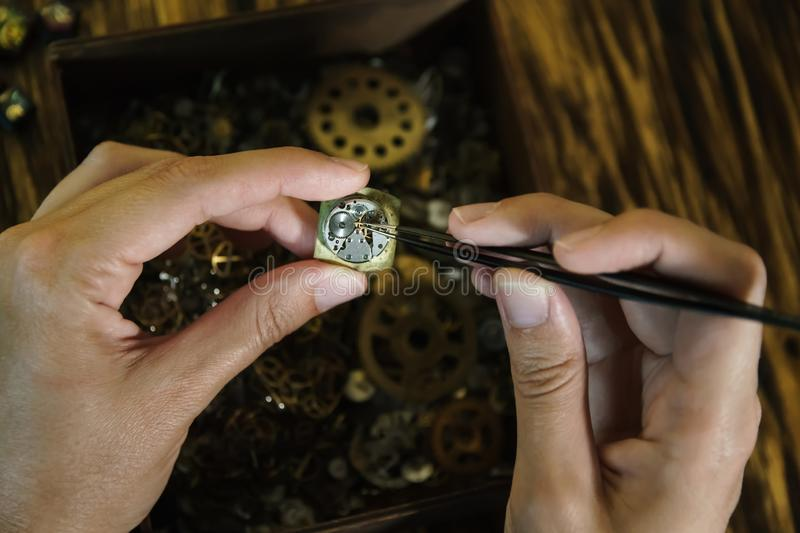 Repairing vintage watches closeup stock photography