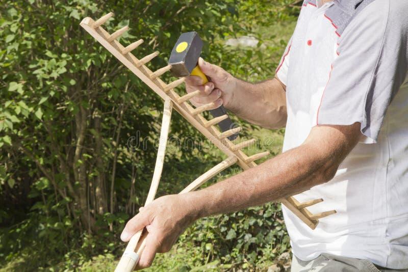 Download Repairing Wooden Rake- Closeup Royalty Free Stock Photos - Image: 25964358