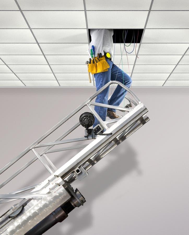 Repairman in the ceiling stock photo