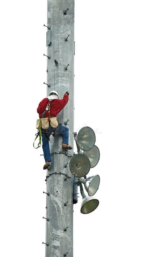 Repairman Climbs ett mobiltelefontorn fotografering för bildbyråer