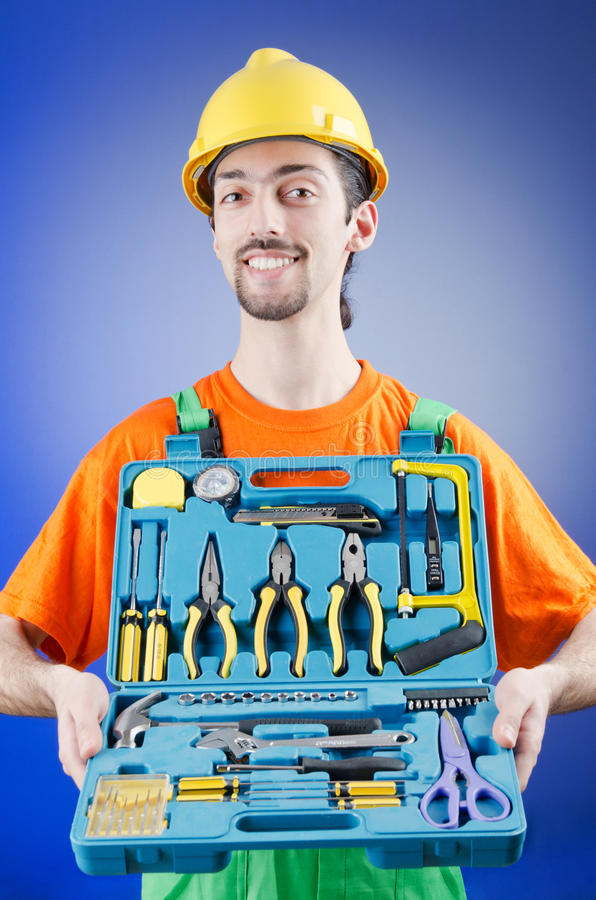 Download Repairman with his toolkit stock photo. Image of tool - 25115002
