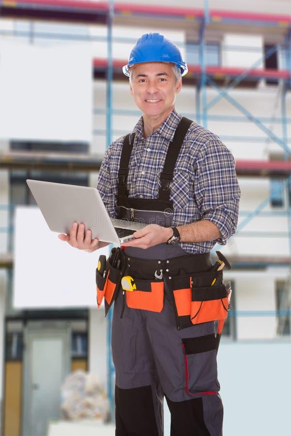 Repairman holding laptop stock photos