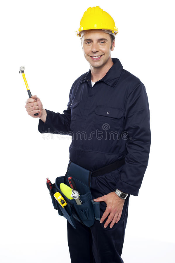 Repairman Holding Out Hammer From His Tool Kit Royalty Free Stock Photography