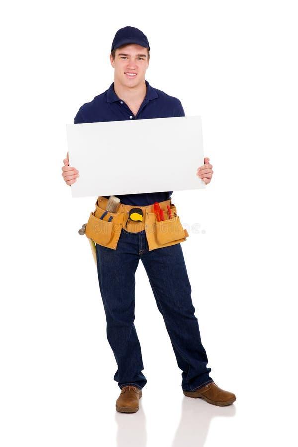 Repairman holding white board royalty free stock image