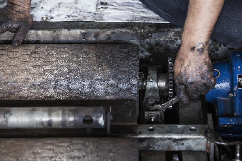 repairman holding a wrench and tighten and during maintenance work of machine stock photo