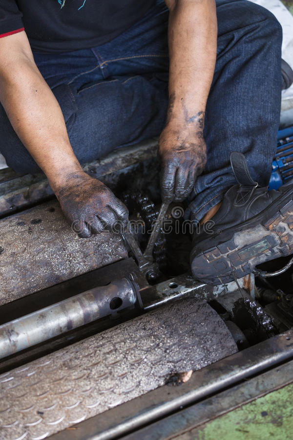 repairman holding a wrench and tighten and during maintenance work of machine stock images