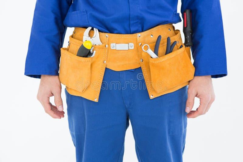 Repairman jest ubranym narzędzie pasek fotografia stock