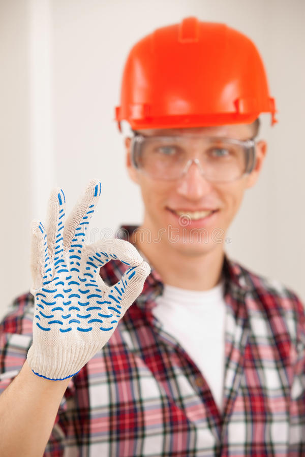 Repairman making a perfect gesture with his gloved hand stock photography