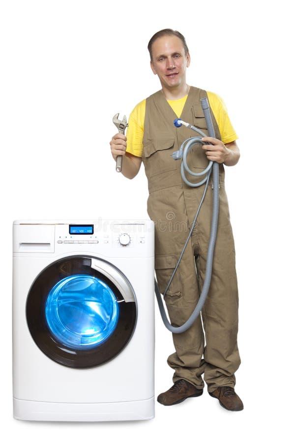 The repairman near the washing machine stock photo