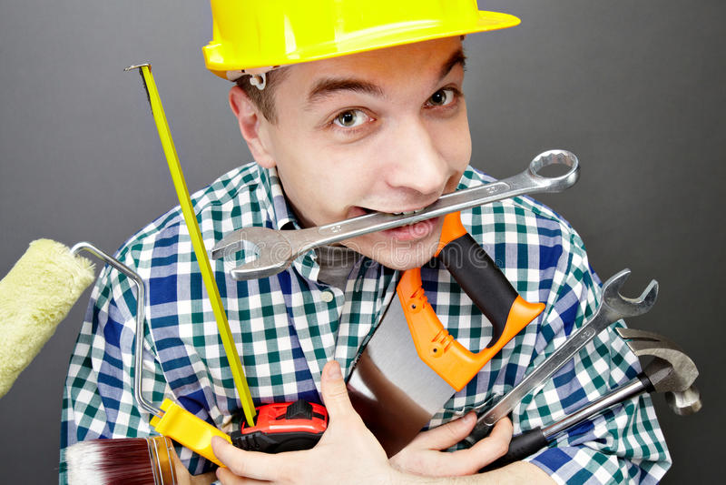 Repairman with tools stock photos