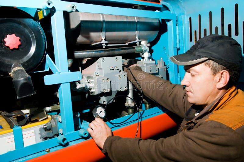 Repairman using manometer. Serviceman repairman measuring the pressure with manometer royalty free stock image