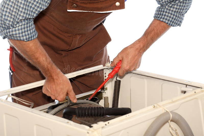 Repairman is working. On a damaged washer stock images