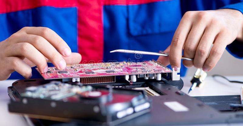 Repairman working in technical support fixing computer laptop tr. Oubleshooting stock photography