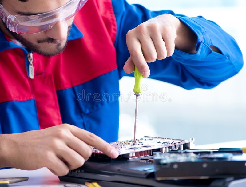 Repairman working in technical support fixing computer laptop tr. Oubleshooting royalty free stock images