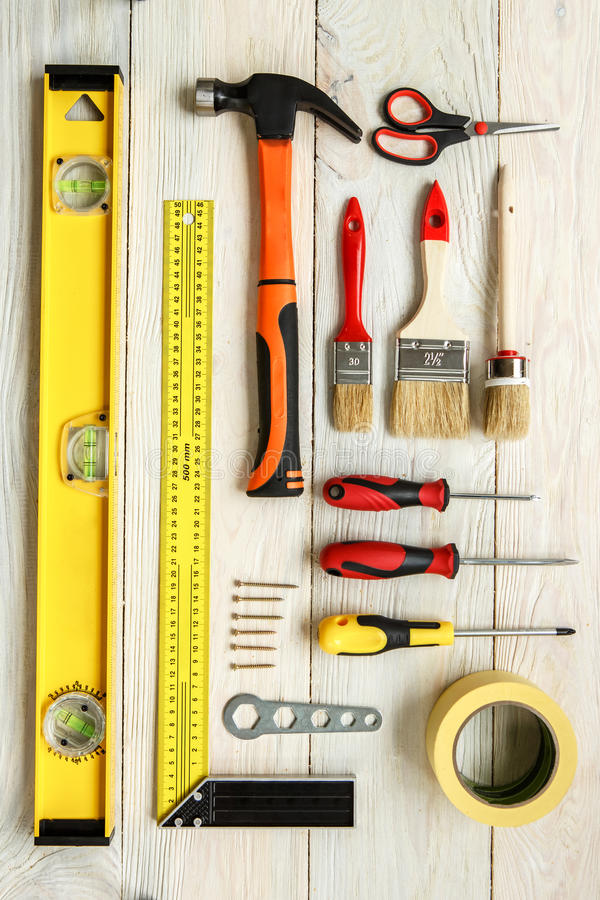 Repairment tools objects on wooden surface stock photo