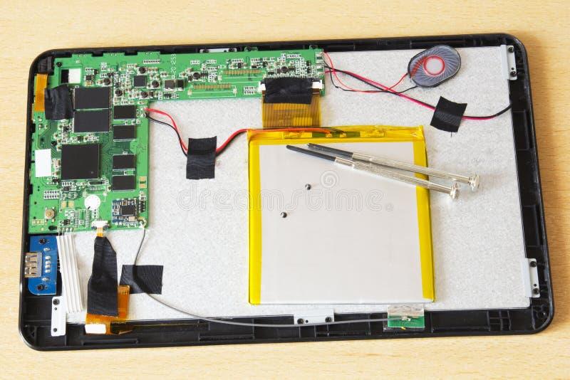 Reparación de la tableta imagen de archivo libre de regalías