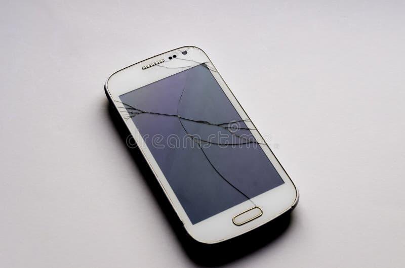 Reparación del teléfono móvil, pantalla quebrada, vidrio agrietado fotografía de archivo