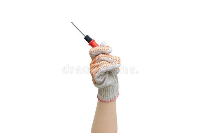 Reparaci?n casera Mano con un destornillador en un guante protector del algodón imagen de archivo libre de regalías