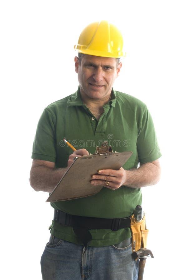 Reparador do contratante com correia e martelo da ferramenta imagens de stock royalty free