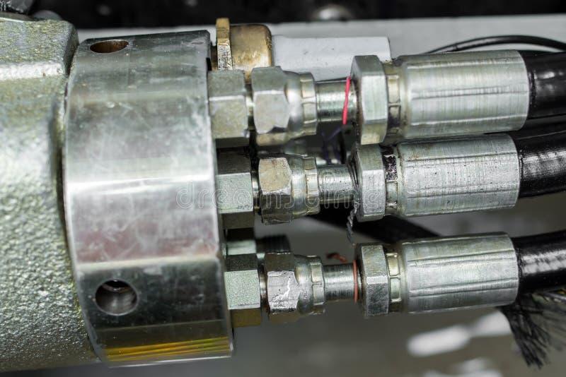 Reparatie en delen van een compacte lader stock afbeelding