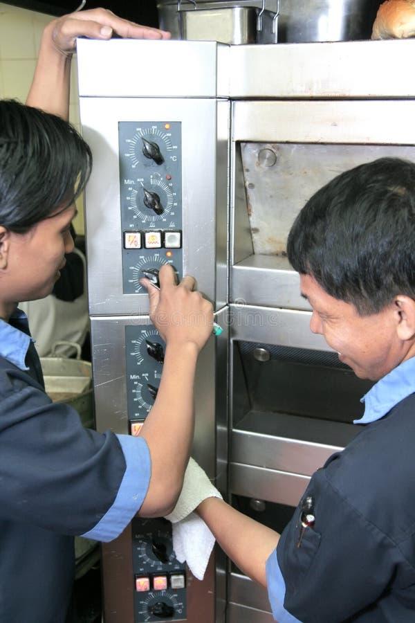 reparationsmaskintekniker royaltyfria foton