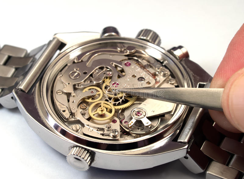 reparera watchen arkivbild