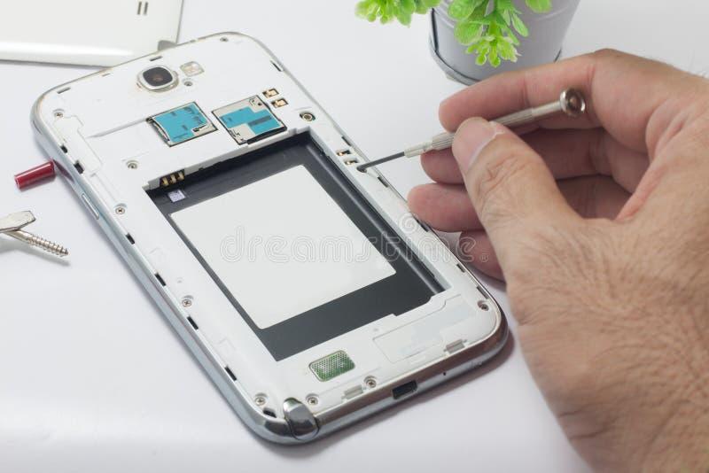 Reparieren Sie Handy stockfotos