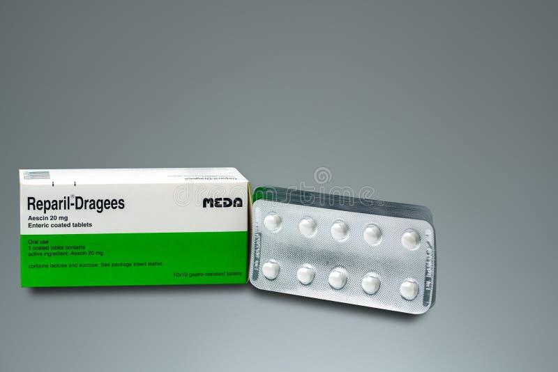 Reparil糖衣杏仁 Meda Pharma泰国Aescin 20毫克伤寒的上漆的片剂产品  制造Gmbh的Madaus,德国 库存照片
