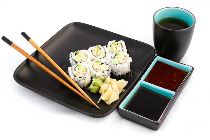 Repas de sushi d'isolement sur le blanc avec le thé photographie stock libre de droits