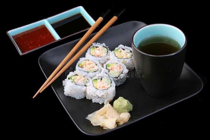 Repas de sushi sur le noir photos stock