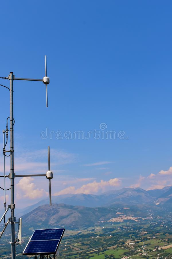 Repeater in the mountain. Repeater antenna powered by solar panels in Comino Valley Italy royalty free stock photos