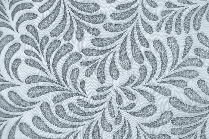 Repeating leaf pattern. Wallpaper. Gray on white royalty free stock photography
