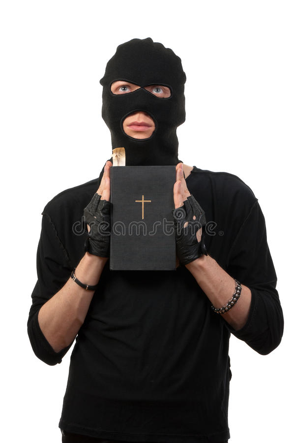 Download Repentant Robber With The Bible Royalty Free Stock Image - Image: 9576736