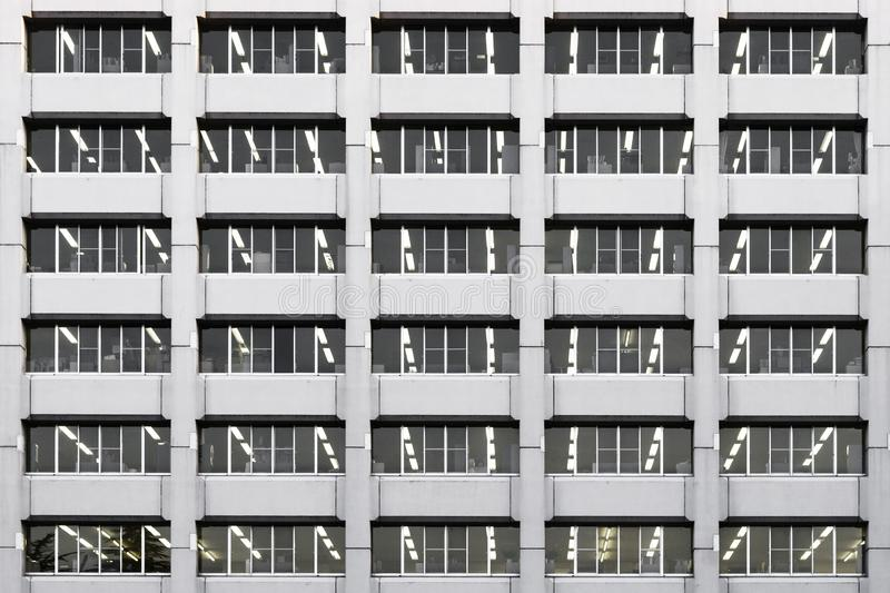 Repetition of Windows office building background and pattern royalty free stock photography