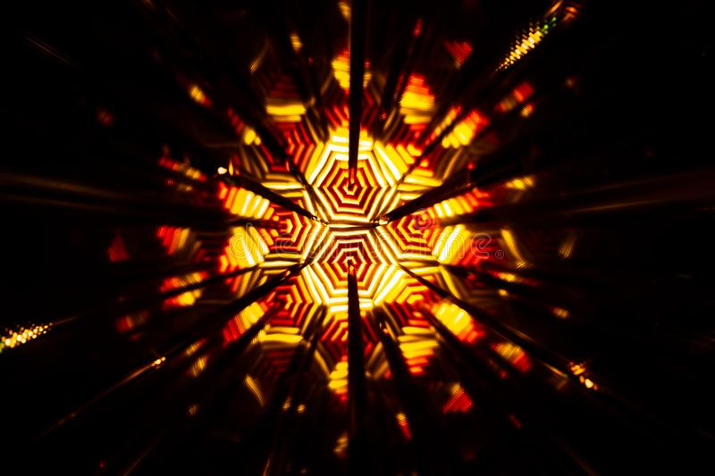 Repetitive pattern by reflections of an image in mirrors. Color kaleidoscopic image. Abstract figure of vibrant tones royalty free stock photo