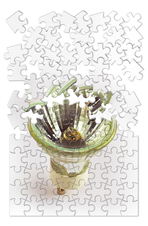 Replace old inefficient incandescent light bulbs - concept image in jigsaw puzzle shape.  stock images