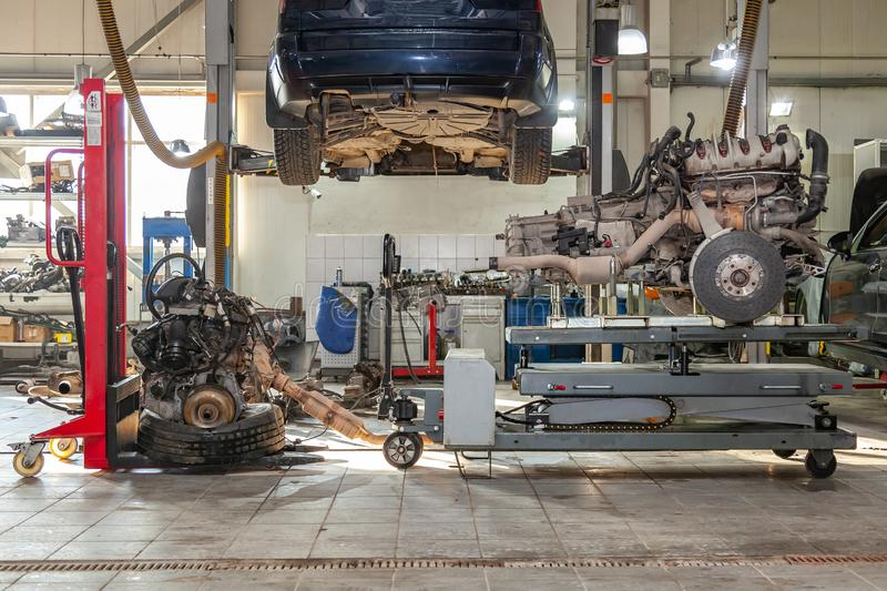 Replacement engine used on a table mounted for installation on a car after a breakdown and repair in a car repair workshop as a royalty free stock photography