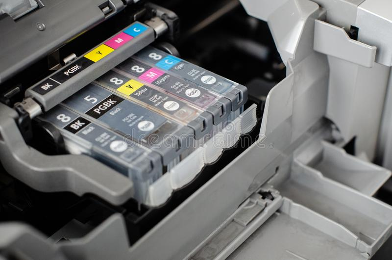 Replacement of inkjet printer cartridges. Close up of printer ink cartridges, ready to be replaced or refilled stock photography
