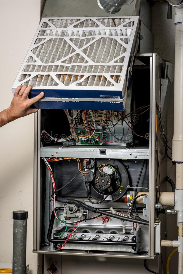 Free Replacement Of Airfilter In A Home Furnace Stock Images - 100062634