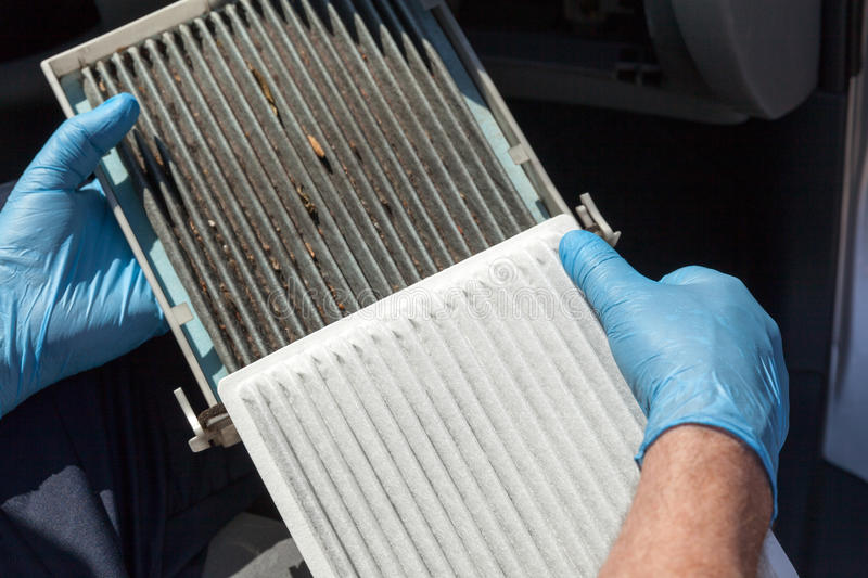 Replacing the cabin air filter. Clean and dirty cabin air filter for car stock photos