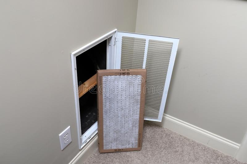 Replacing clean Air filter for home air conditioner royalty free stock photography