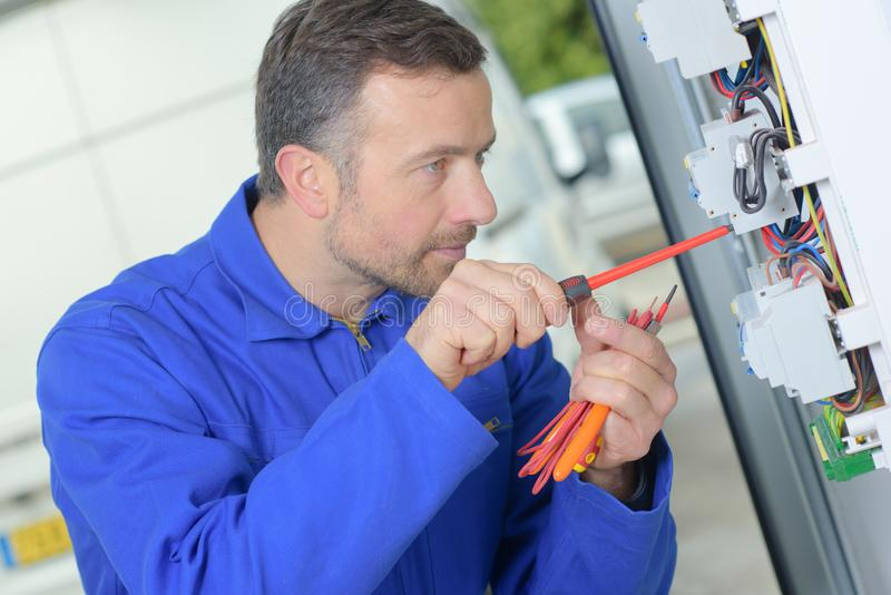 Replacing a faulty fuse. Assemble stock images